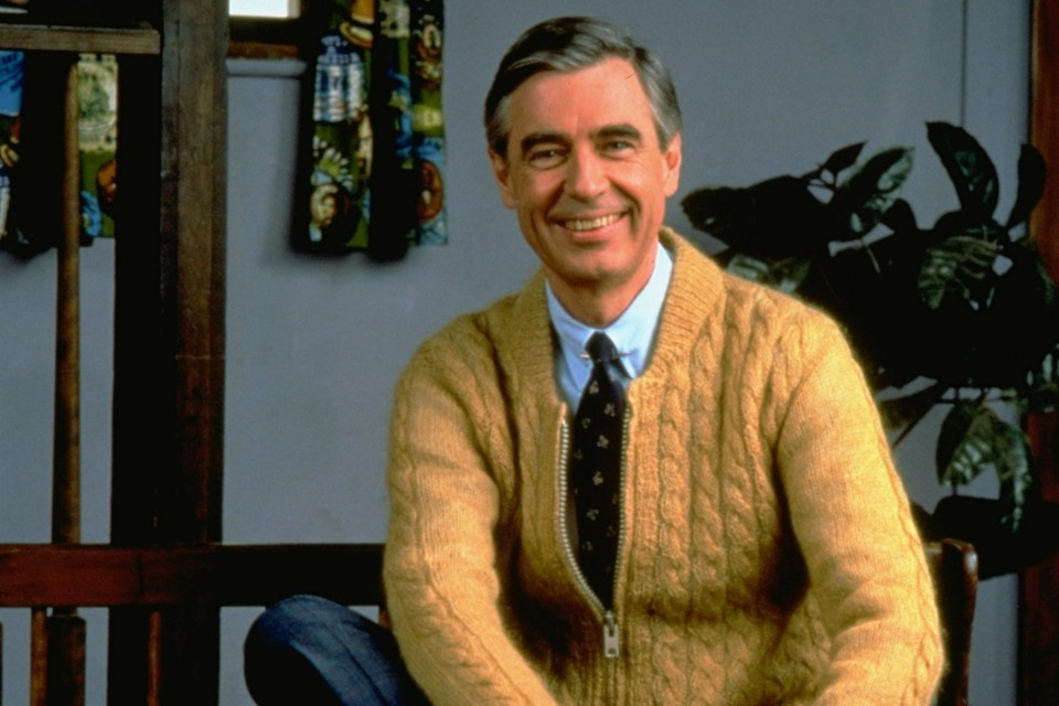 Fred Rogers poses on the Pittsburgh set of his television show Mister Rogers' Neighborhood, in this 1996 publicity photo. Rogers' new book, Dear Mister Rogers: Does It Ever Rain in Your Neighborhood?, is a treasury of letters from young viewers, and Rogers' responses. (AP Photo/pool)